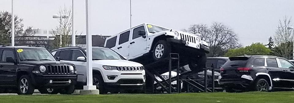 Unsold Jeep vehicles on lot in Troy, Michigan.
