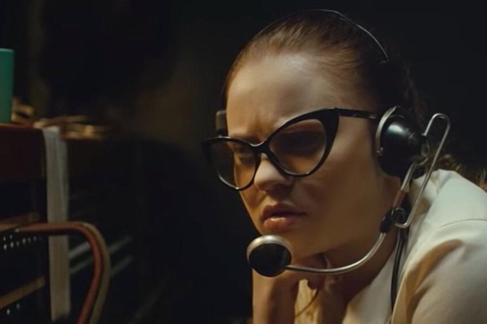 Sierra McCormick, as Fay Crocker, hears strange sounds over her switchboard in Andrew Patterson's 'The Vast of Night'