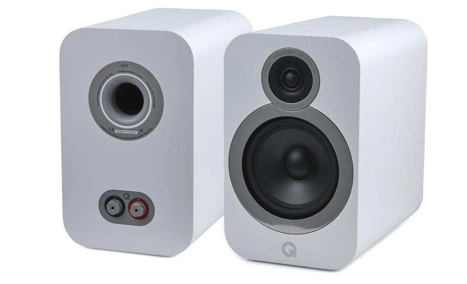 AN artic white pair of Q Acoustics 3030i speakers shown front and back