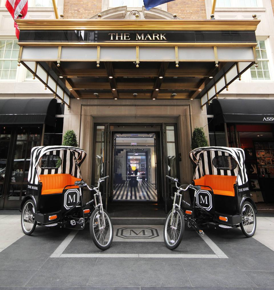 Two Pedi Cabs in front of the Mark Hotel.