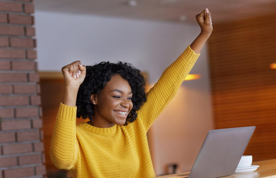 Worker excited about a positive employee experience.