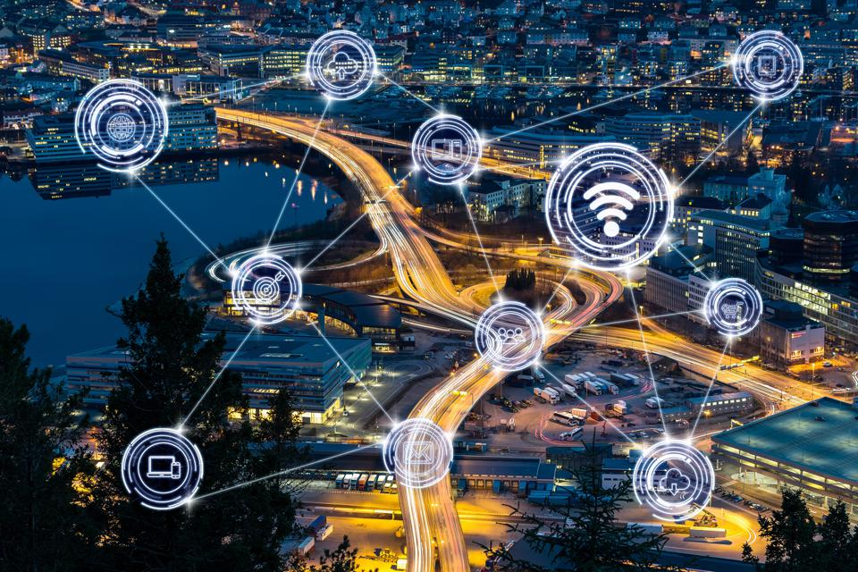 business IOT concept, Wireless communication connecting of smart city Internet of Things Technology over Top view express way with traffic light at the Bergen cityscape at the sunset time, Norway