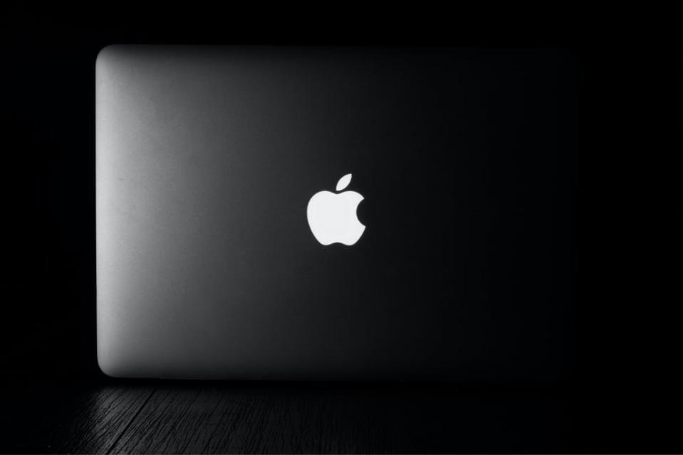 An Apple logo on an Apple MacBook laptop
