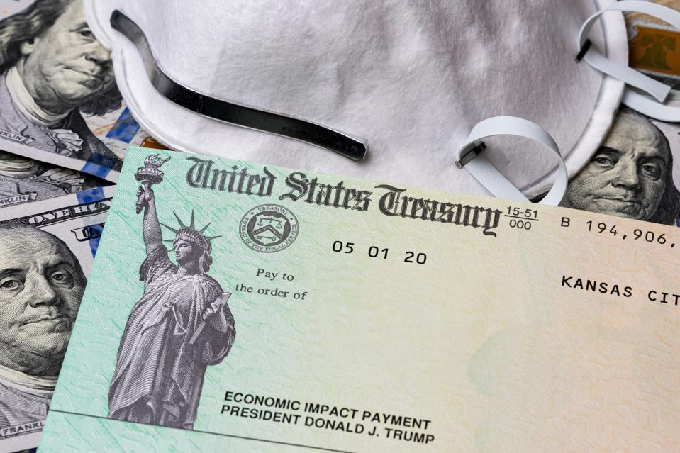 Stimulus check, economic impact payment from Treasury department. 100 dollar bills