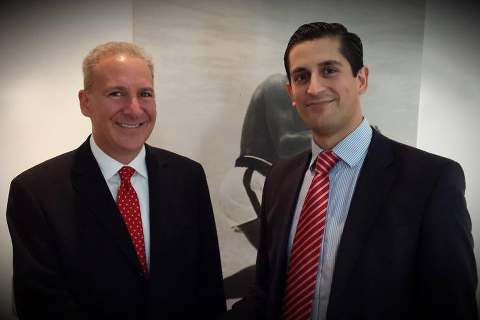 A picture of gold bug Peter Schiff and Alessio Rastani