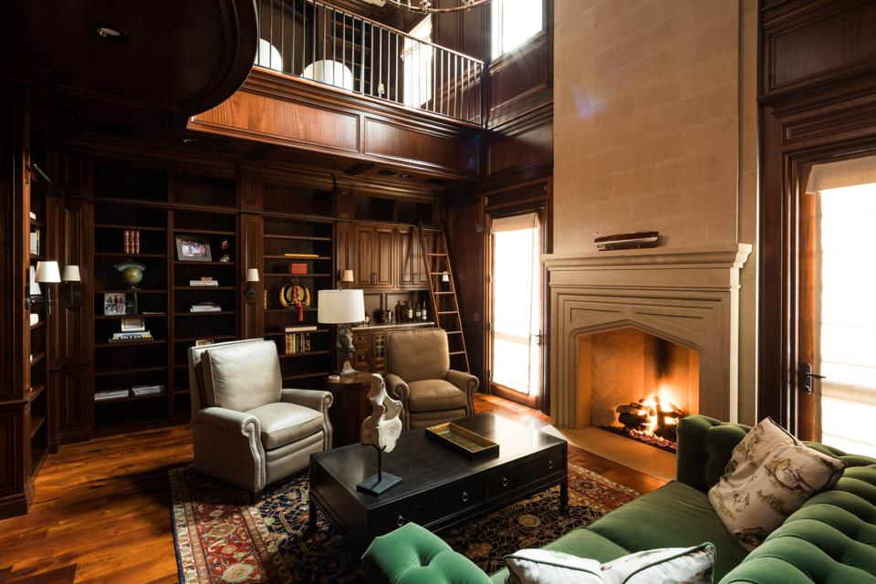 two-story library with a fireplace