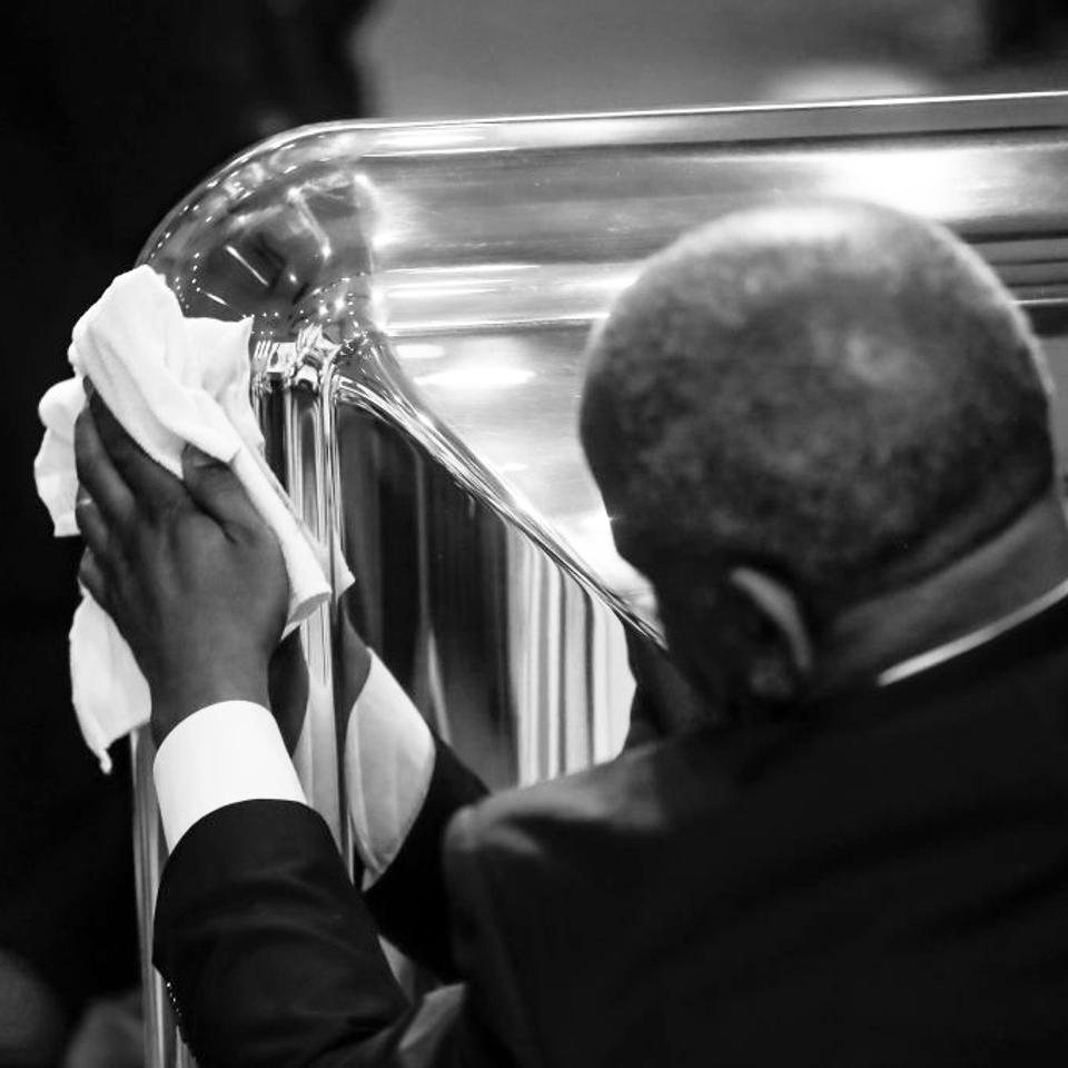 A man polishes a casket.