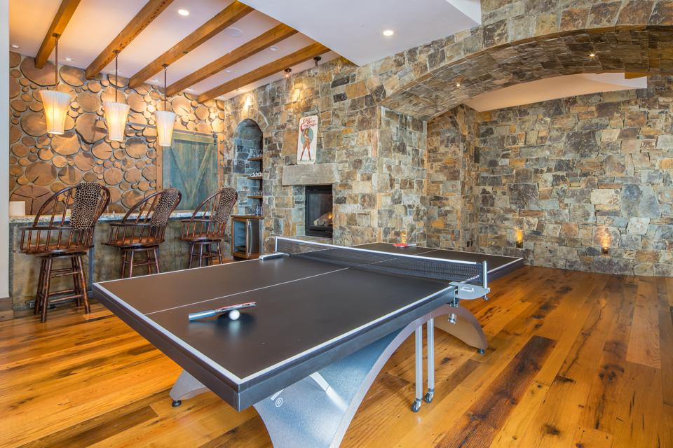 On the home's lower level there is a home theater, recreation room, a playroom/game room, home gym, study, and changing rooms adjacent to the outdoor hot tub.