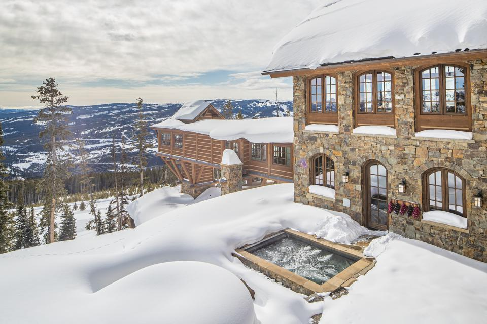 """The home's most prominent architectural feature is a """"ski bridge"""" that extends from the main house to an elevator that descends 31 feet to the ski room."""