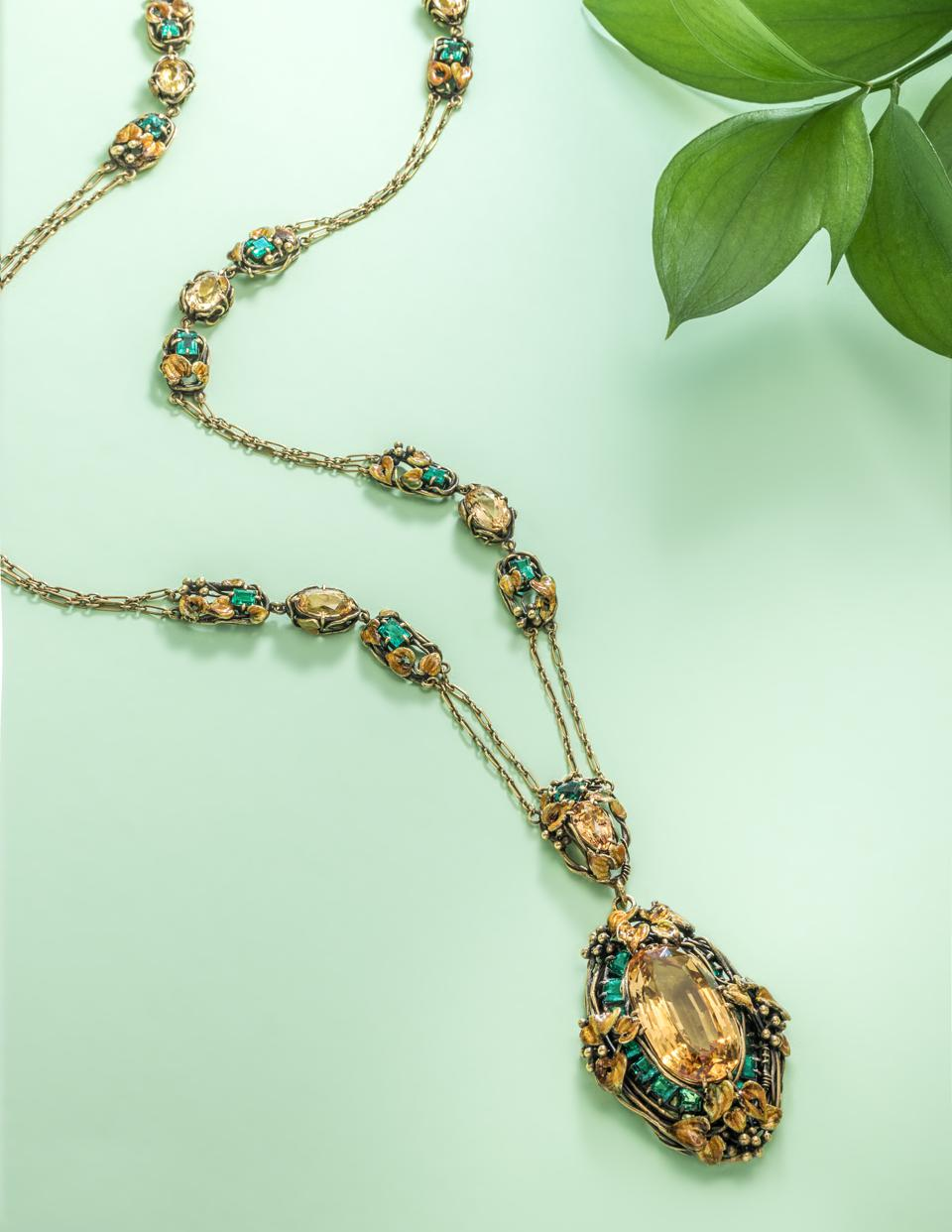 Antique pendant necklace with yellow sapphire and emeralds