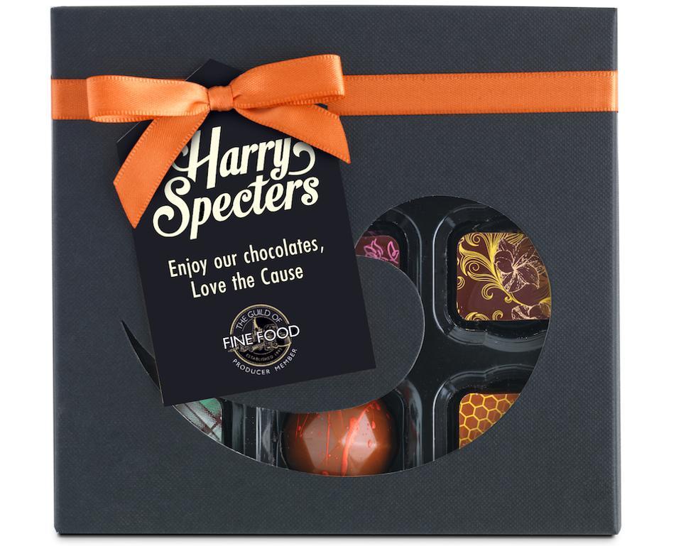 chocolates in a box with orange ribbon