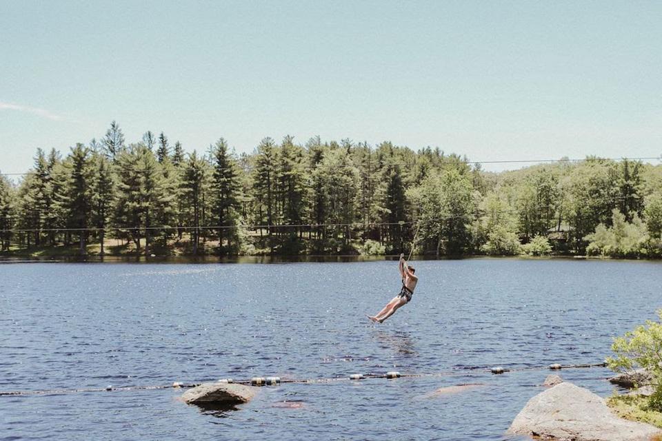 Ziplining over the lake at Cedar Lakes Estate Hudson Valley New York