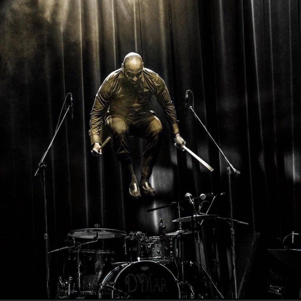 D'Mar jumps up off his drum stool/