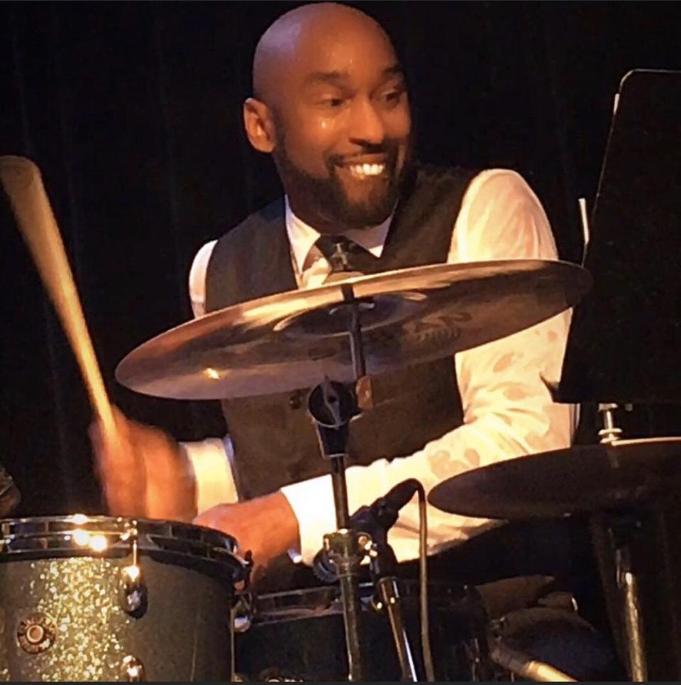 D'Mar on drums in his groove