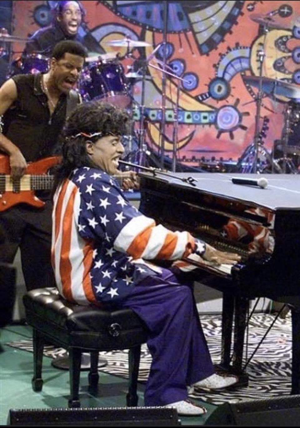 Little Richard playing with bass player Charles Glenn and D'Mar in drums