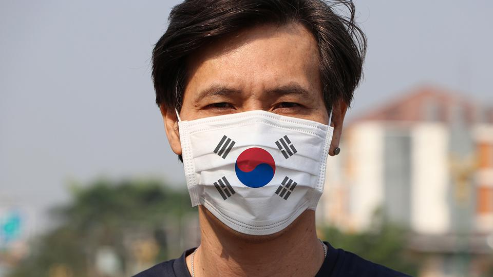 South Korean man wearing a mask.