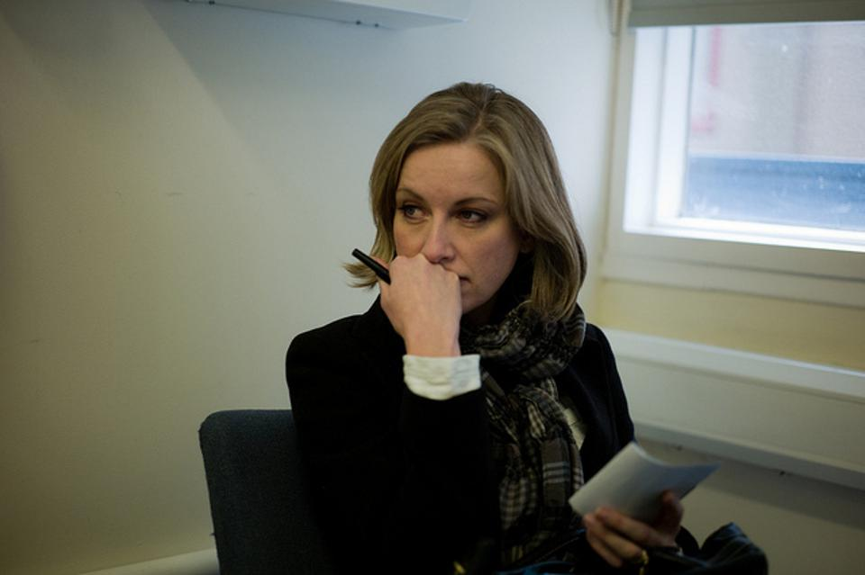 A woman sitting and worrying