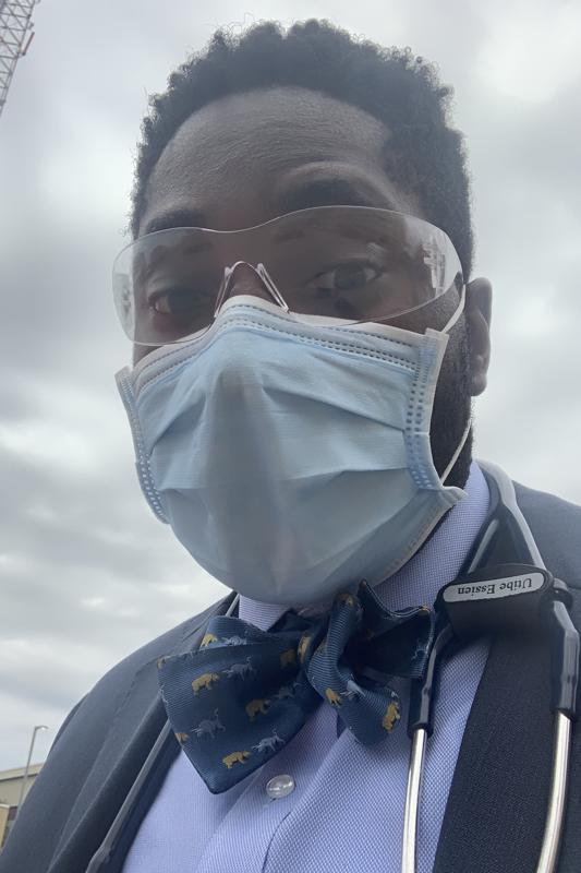 Utibe R. Essien, a physician on the way to work is pictured outside with bowtie on.