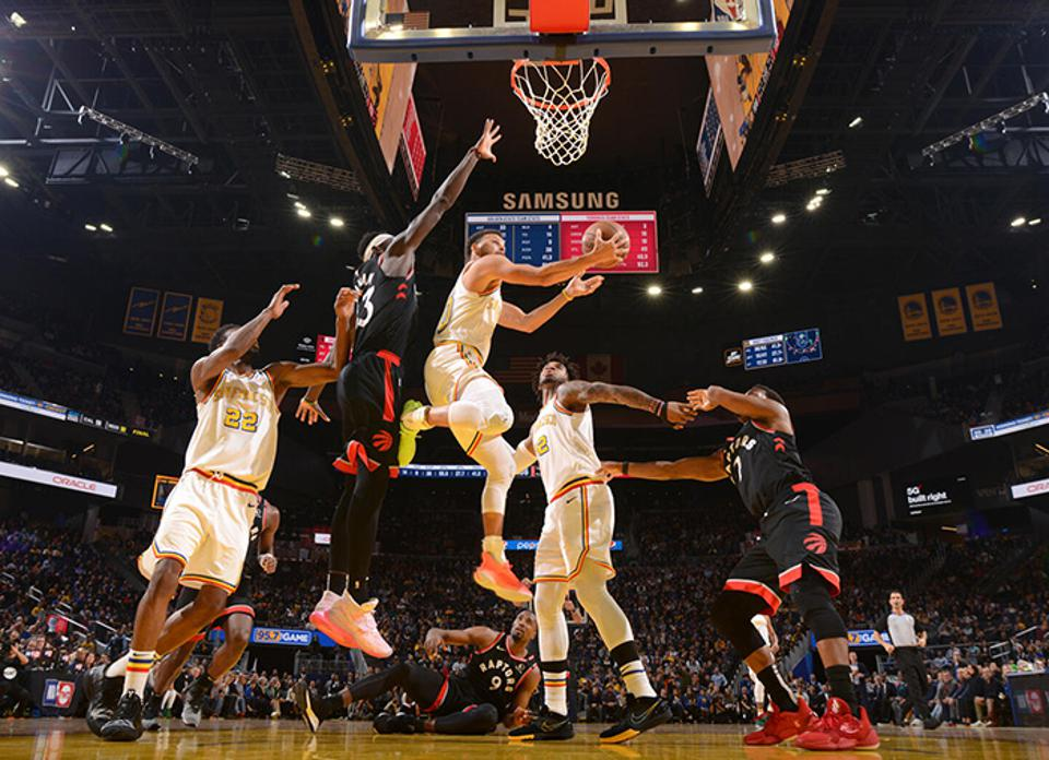 Golden State's Steph Curry finds a way to the rim in a game held in early March against the Toronto Raptors.