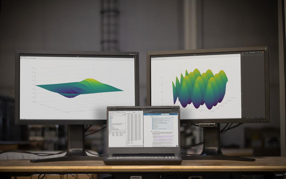 The System76 Serval workstation laptop with multiple monitors