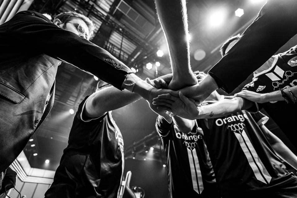 The team Vitality League of Legends team huddle before a match.