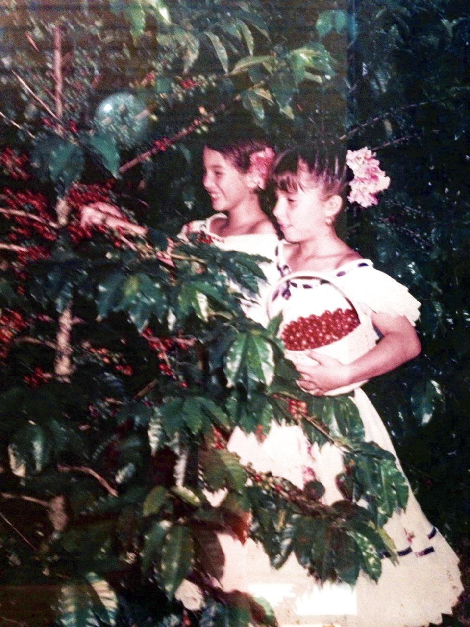 Progeny Coffee's founder Maria Palacio at 12 years old picking coffee on her father's coffee farm in Colombia.