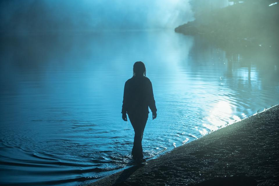 The doppelgänger (Mihaela Dorlan) emerging from the lake in Netflix's 'Curon'