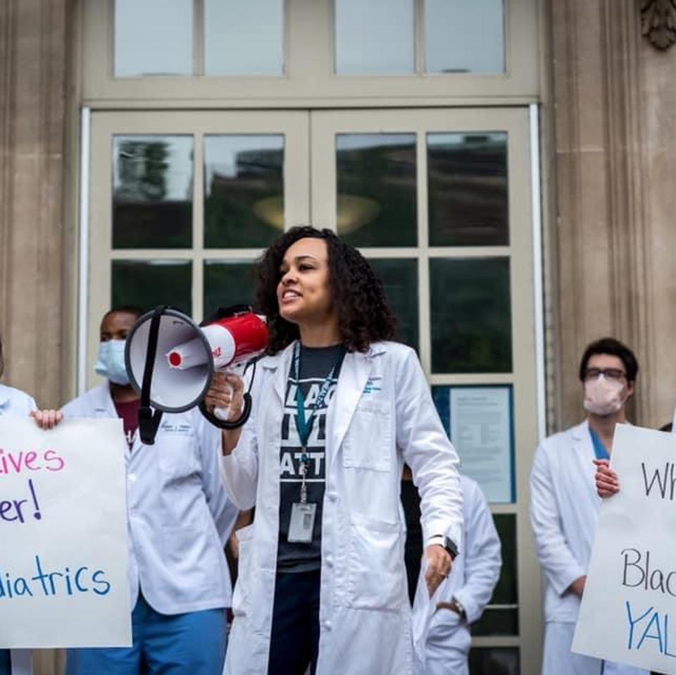 Amanda Calhoun, MD with a megaphone addressing crowd of White Coats for Black Lives rally