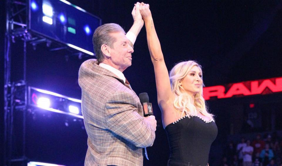 Charlotte Flair poses with Vince McMahon after being added to the WrestleMania main event.