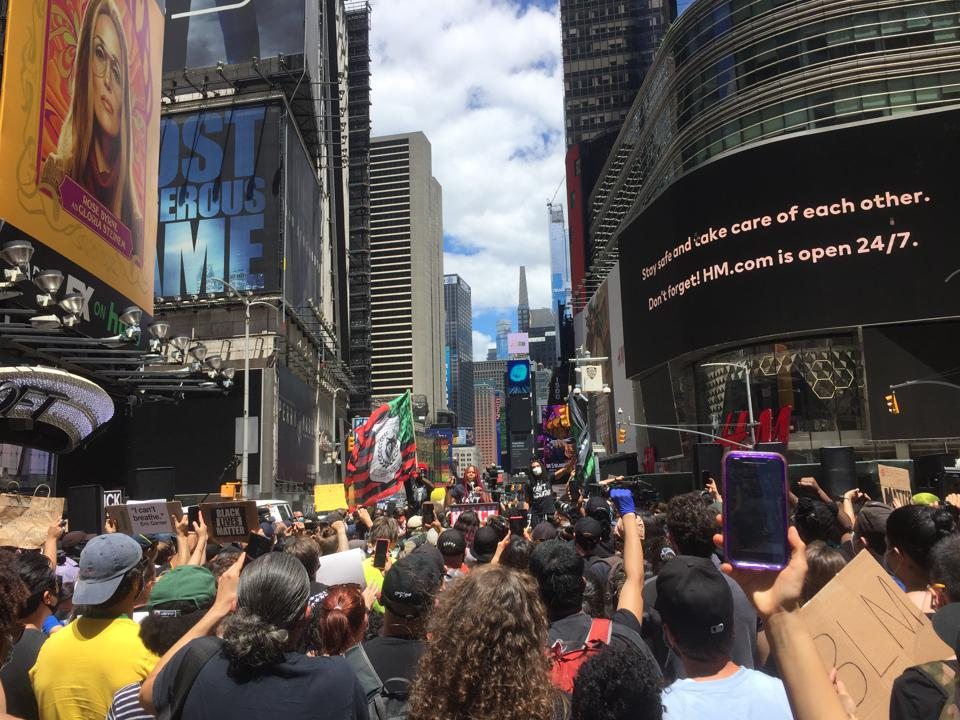 Nupol Kiazolu, president of Black Lives Matter NYC, speaks at a protest in Times Square.