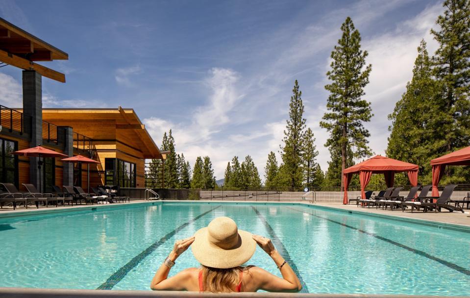 Woman in swimming pool at California resort