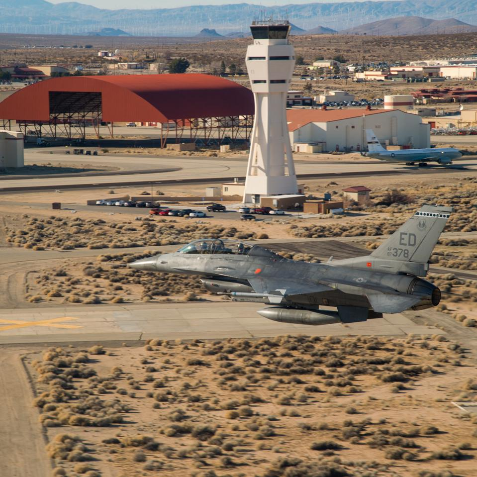 A 416th Flight Test Squadron F-16 low over Edwards AFB, NV.