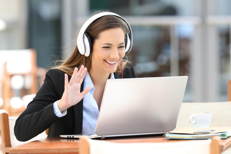 woman online mentoring video call on laptop