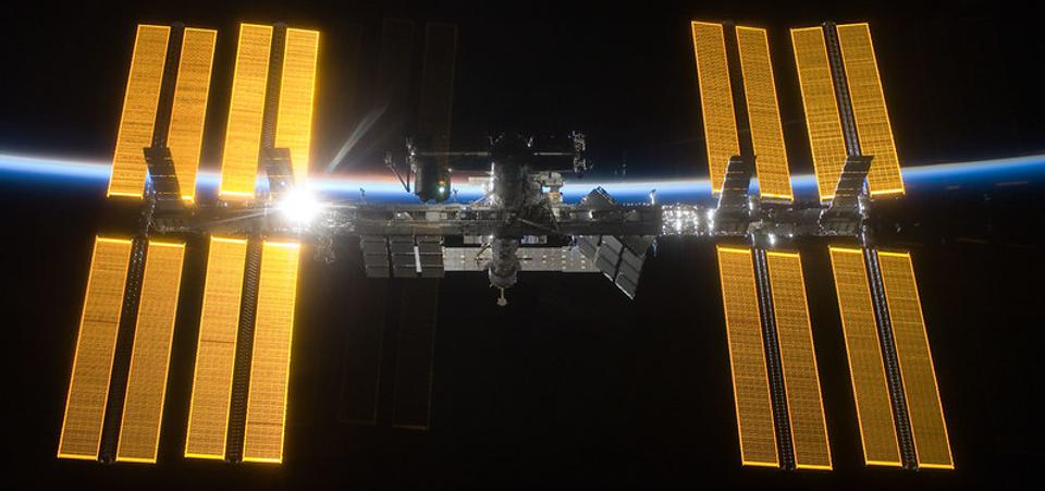 The International Space Station is seen from Space Shuttle Discovery in 2009 as the two spacecraft begin their relative separation.