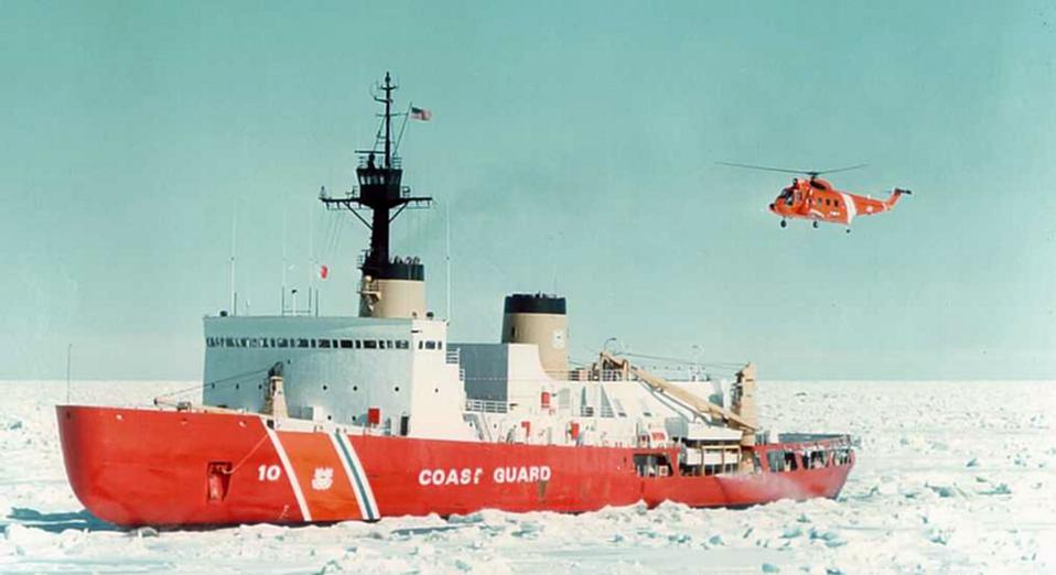 An icebreaker traveling through icy water