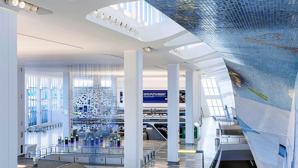 LaGuardia Terminal B in Queens, New York showing airy atrium. Tiled mosaic wall