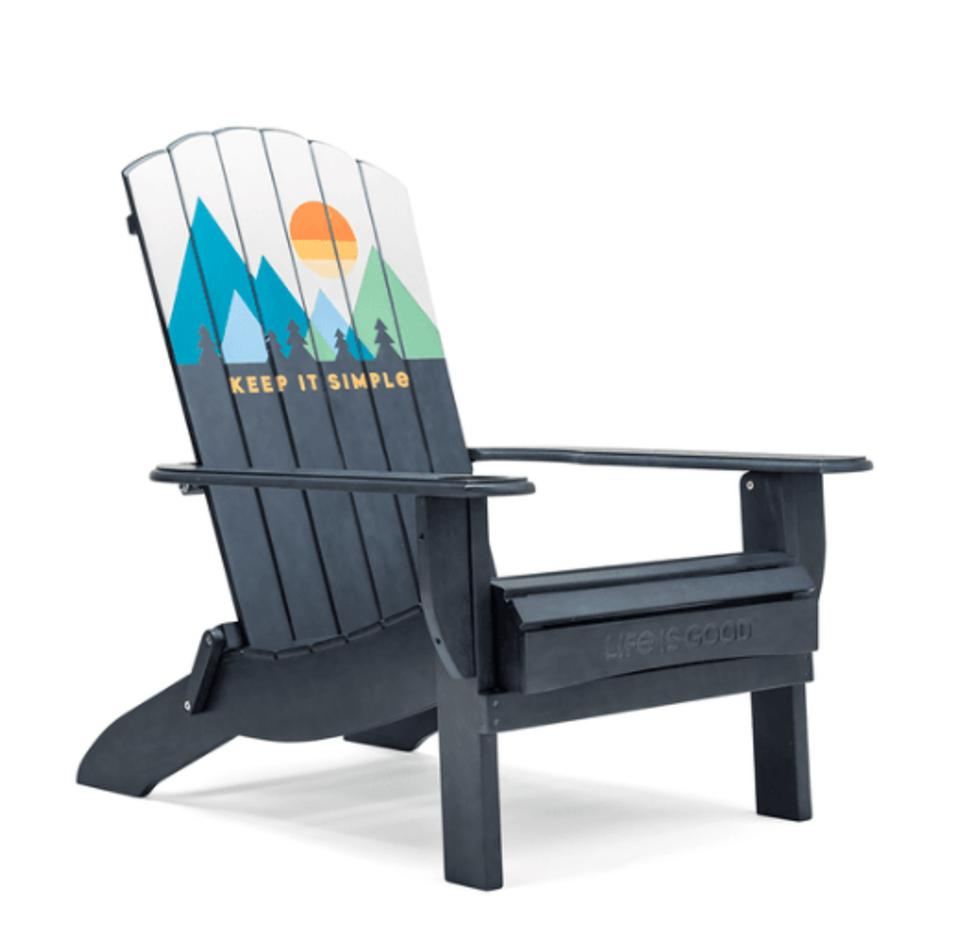adirondack chair with mountain background.