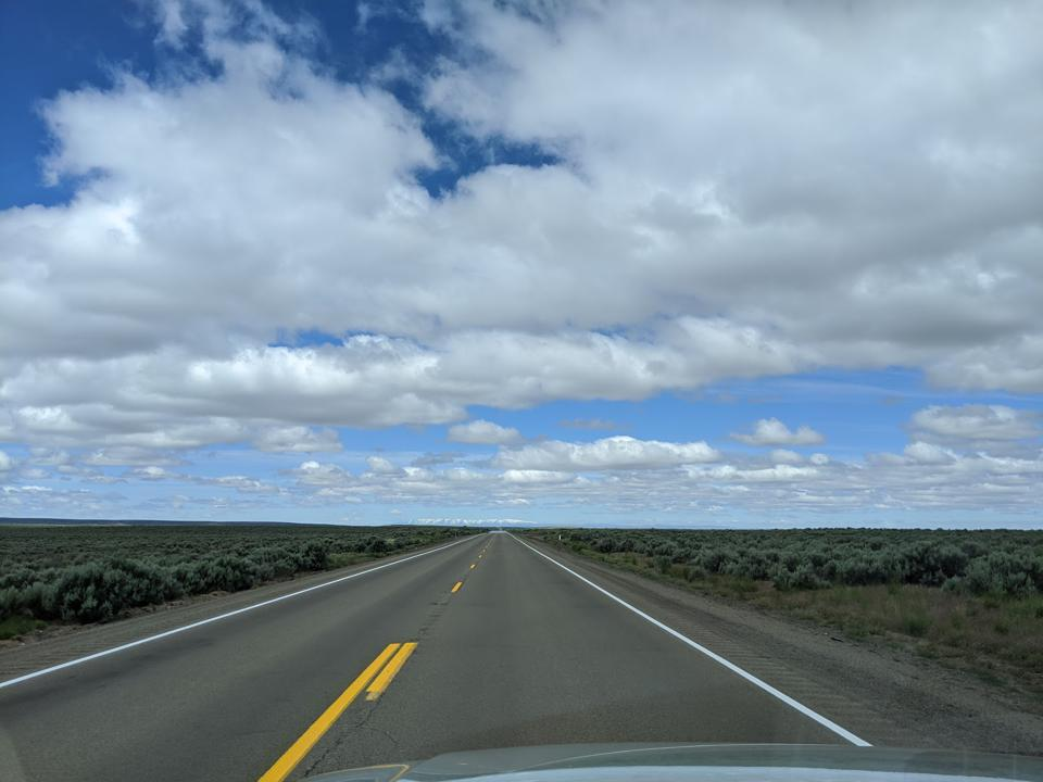 Highway 95 in Oregon with a view of the Steens range in the distance.