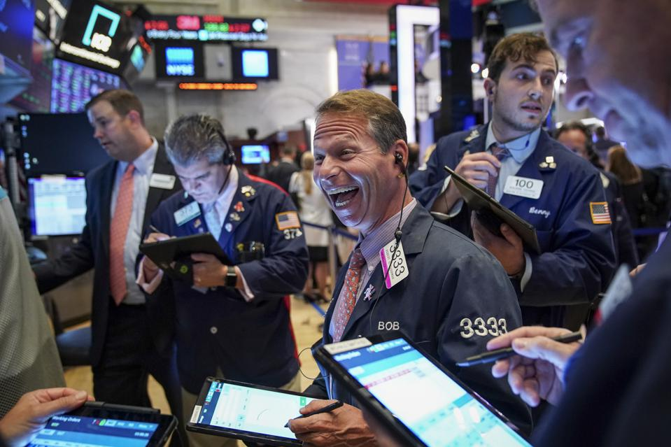 A scene from New York Stock Exchange in 2019 - traders and financial professionals are mainly white men.