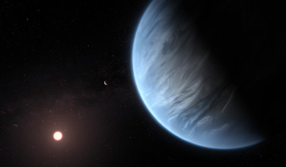 This artist's impression shows the planet K2-18b, it's host star and an accompanying planet in this system. K2-18b is now the only super-Earth exoplanet known to host both water and temperatures that could support life.