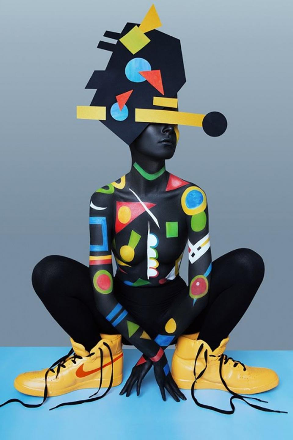 Geometric lines and big yellow shoes on model