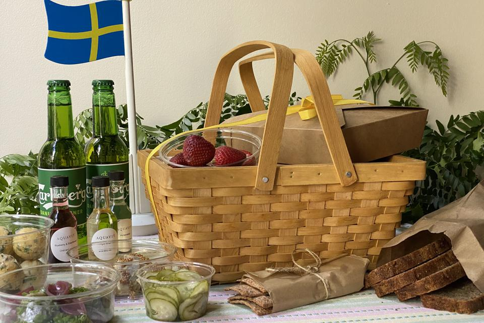 Aquavit's Midsummer picnic basket on a table