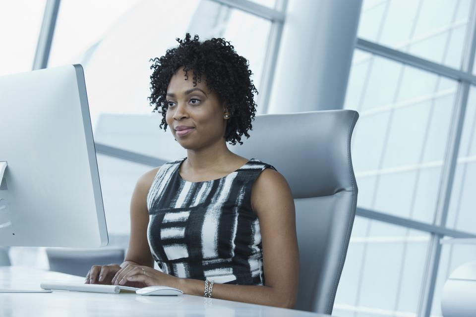 Black businesswoman working in office