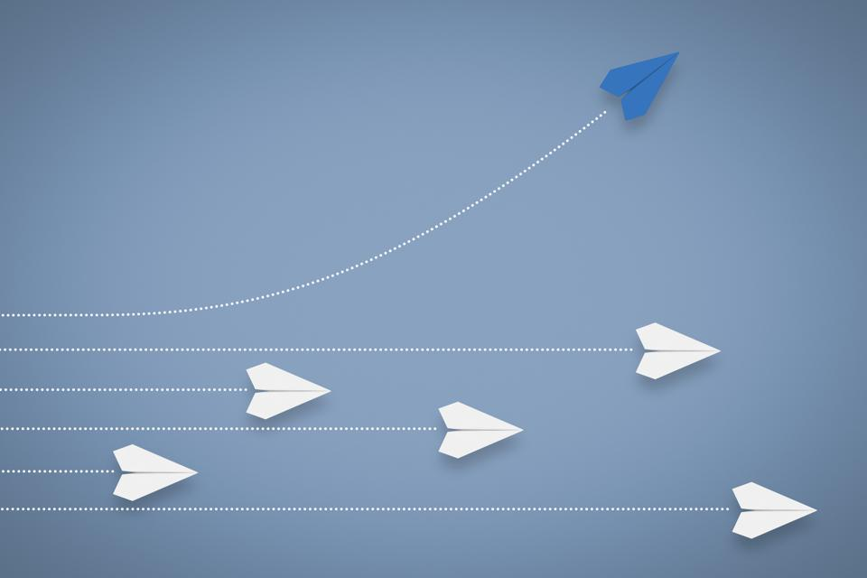 Paper Airplane Different Direction and Approach. Think Different & Leadership Concept.
