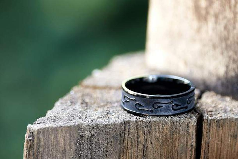 The Gifford, made of black zirconium with fish hook designs for the father who loves fishing.