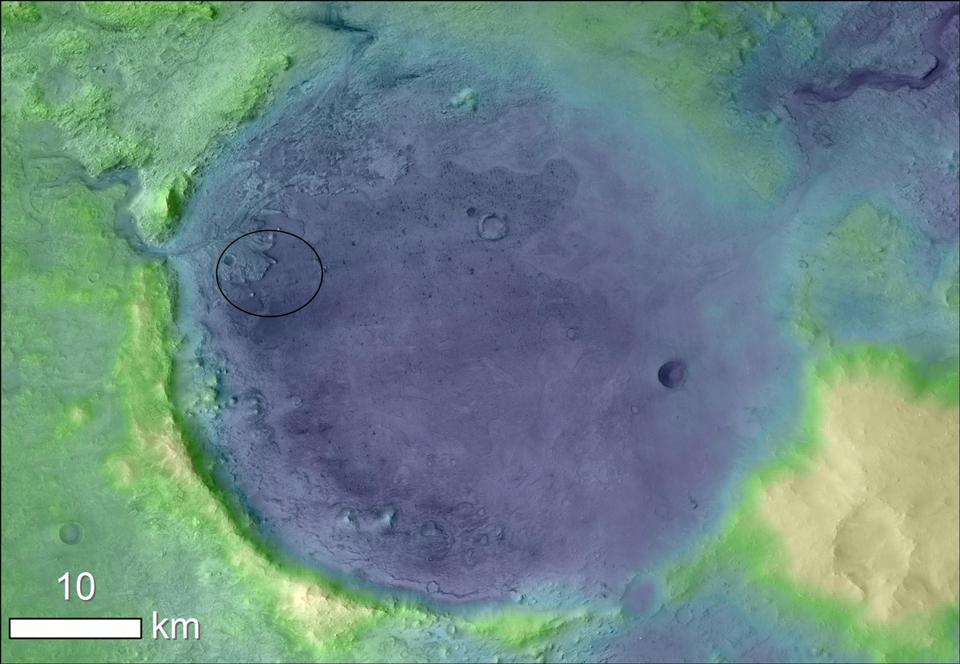 Jezero Crater on Mars, the landing site for NASA's Mars 2020 mission. The oval shows the landing ellipse where the rover touches Mars.  The color added to this image helps to highlight the crater rim and makes it easier to see the coastline of a lake that dried up billions of years ago.