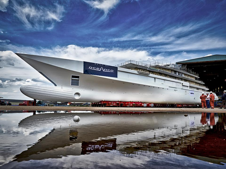 The newest, 313-foot-long superyacht emerges from Oceanco's construction facility in Holland.