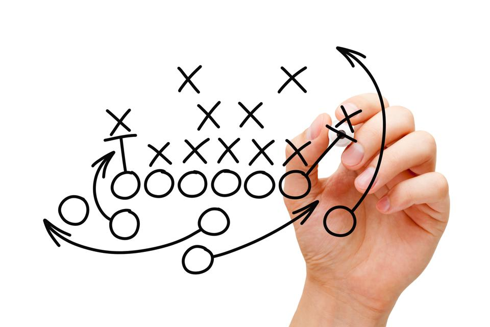 Coach Drawing American Football Playbook Strategy