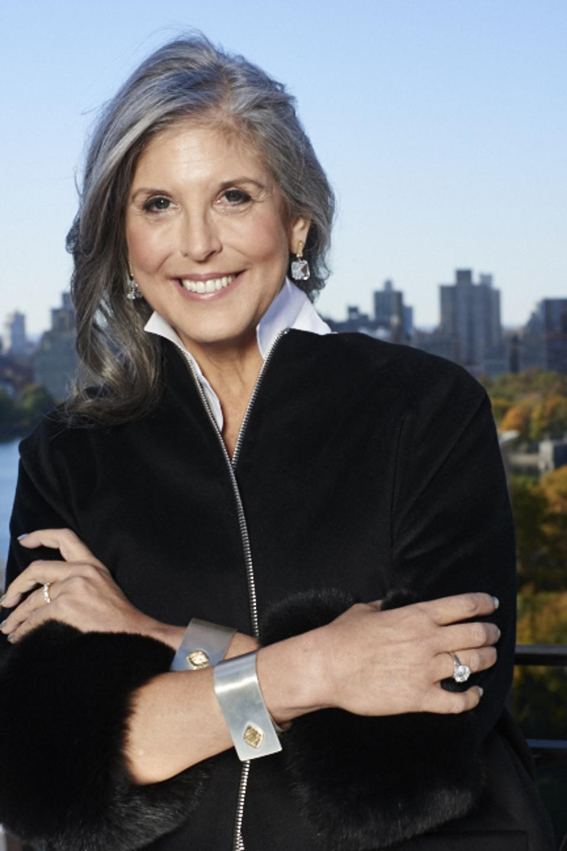 New York-based jewelry designer Joan Hornig wearing her French cuff bracelets.