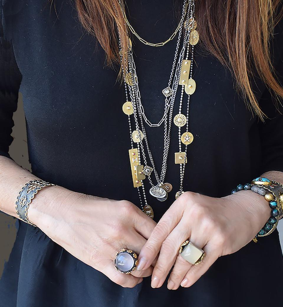 Designer Stella Flame is decked out in her Story Chain necklaces.